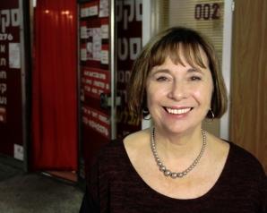 Dr Katherine Snyder in front of shop